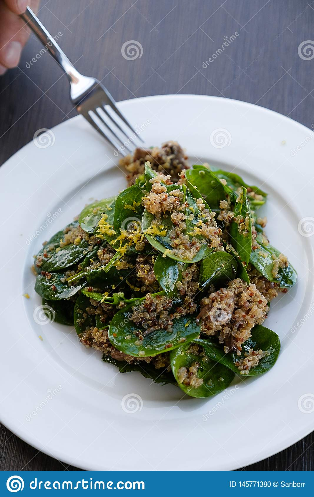 Salad with Quinoa and herbs. Vegetarian dish, food. Vegan dish. Vegetarian and vegan diet. Healthy food. Health food. Proper diet