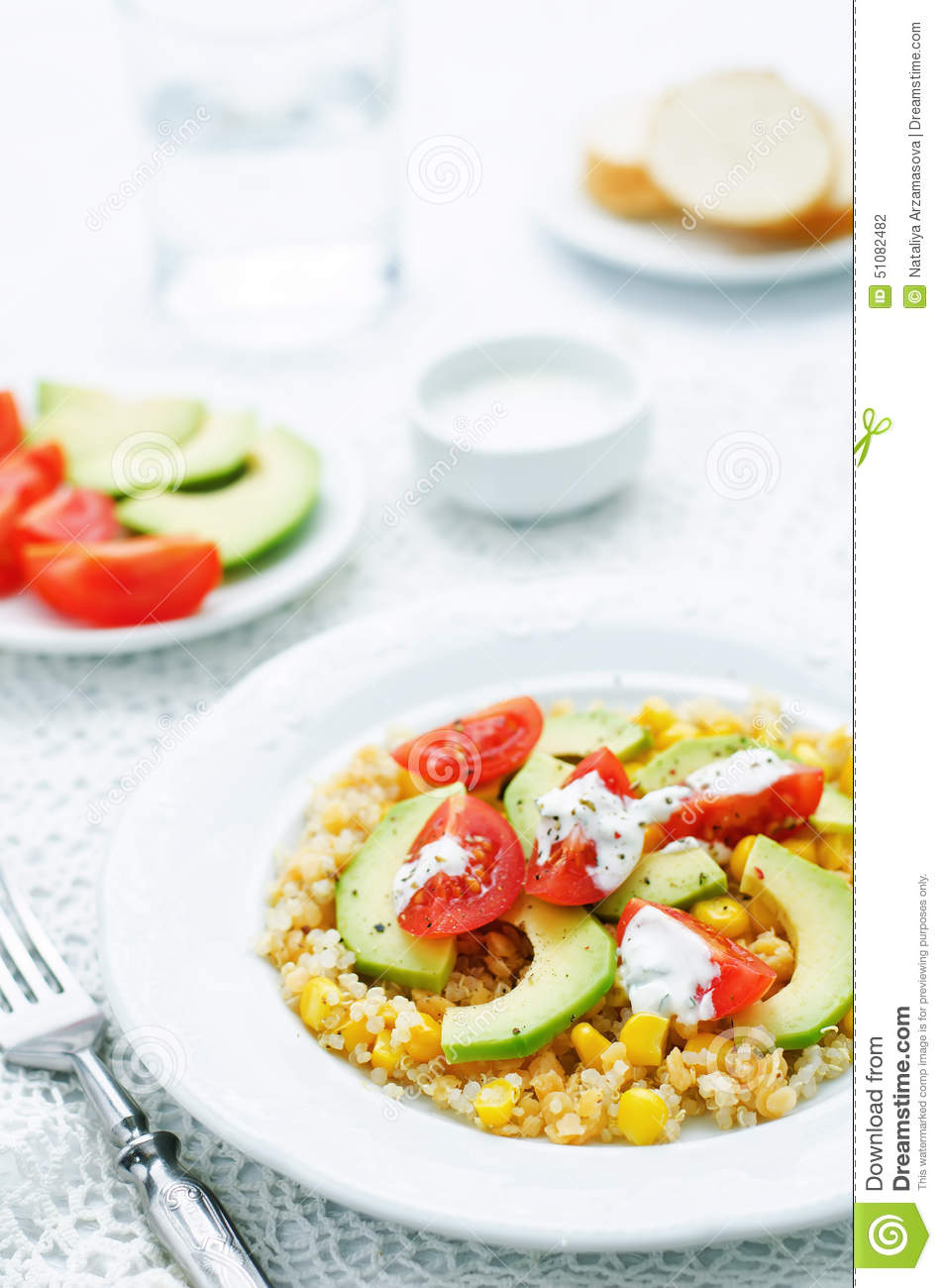 Salad with quinoa, red lentils, corn, avocado and tomato with yo