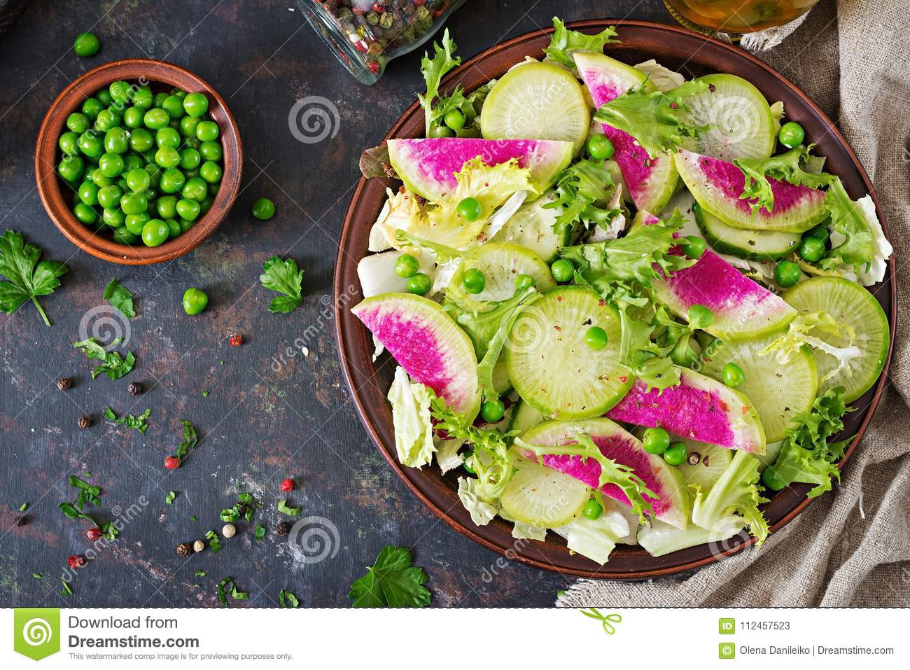 Salad from radish, cucumber and lettuce leaves. Vegan food. Dietary menu.