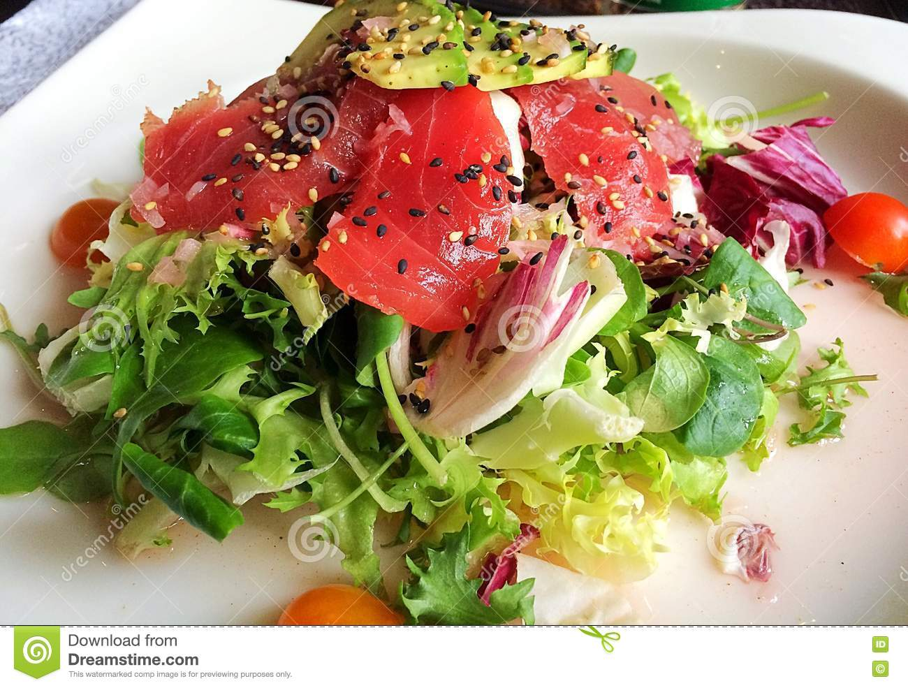 Close-up Of Salad With Raw Tuna Fish, Avocado And Sesame Seeds Stock ...