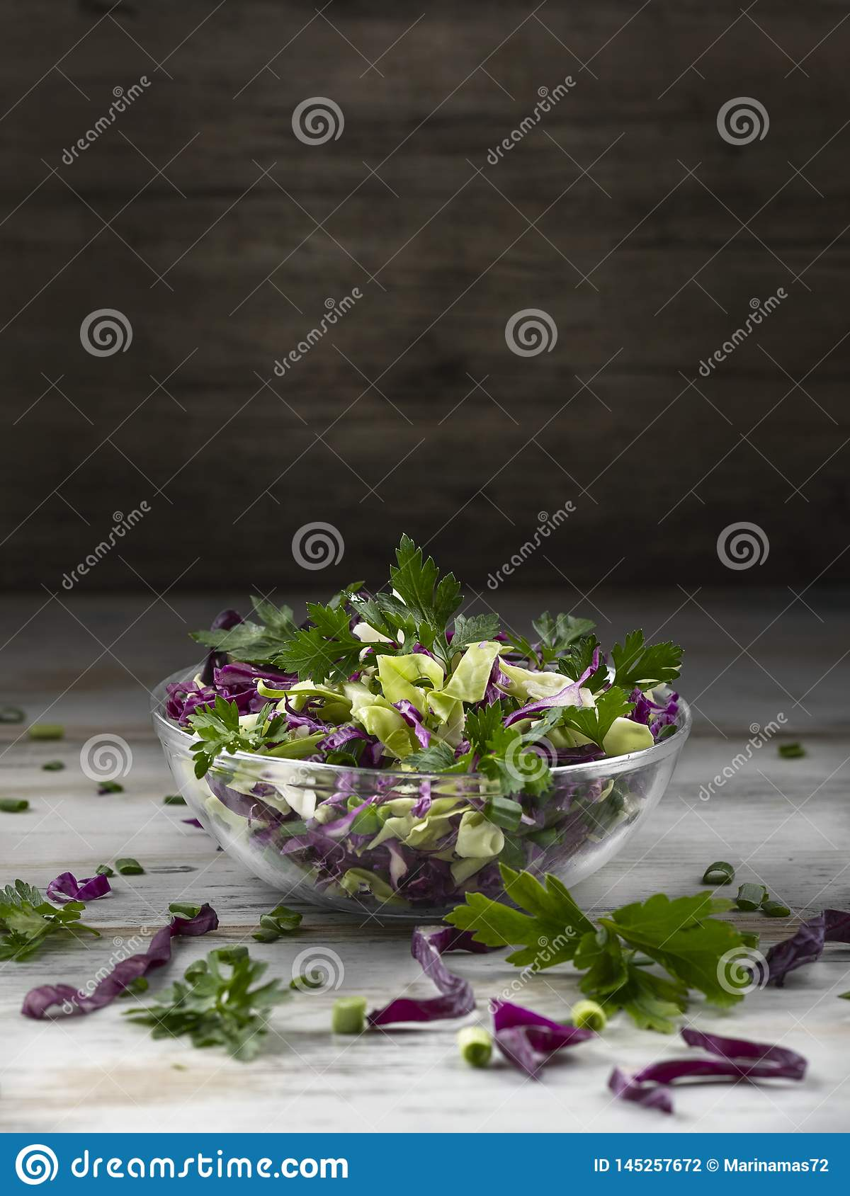 Salad of red cabbage in a glass salad bowls