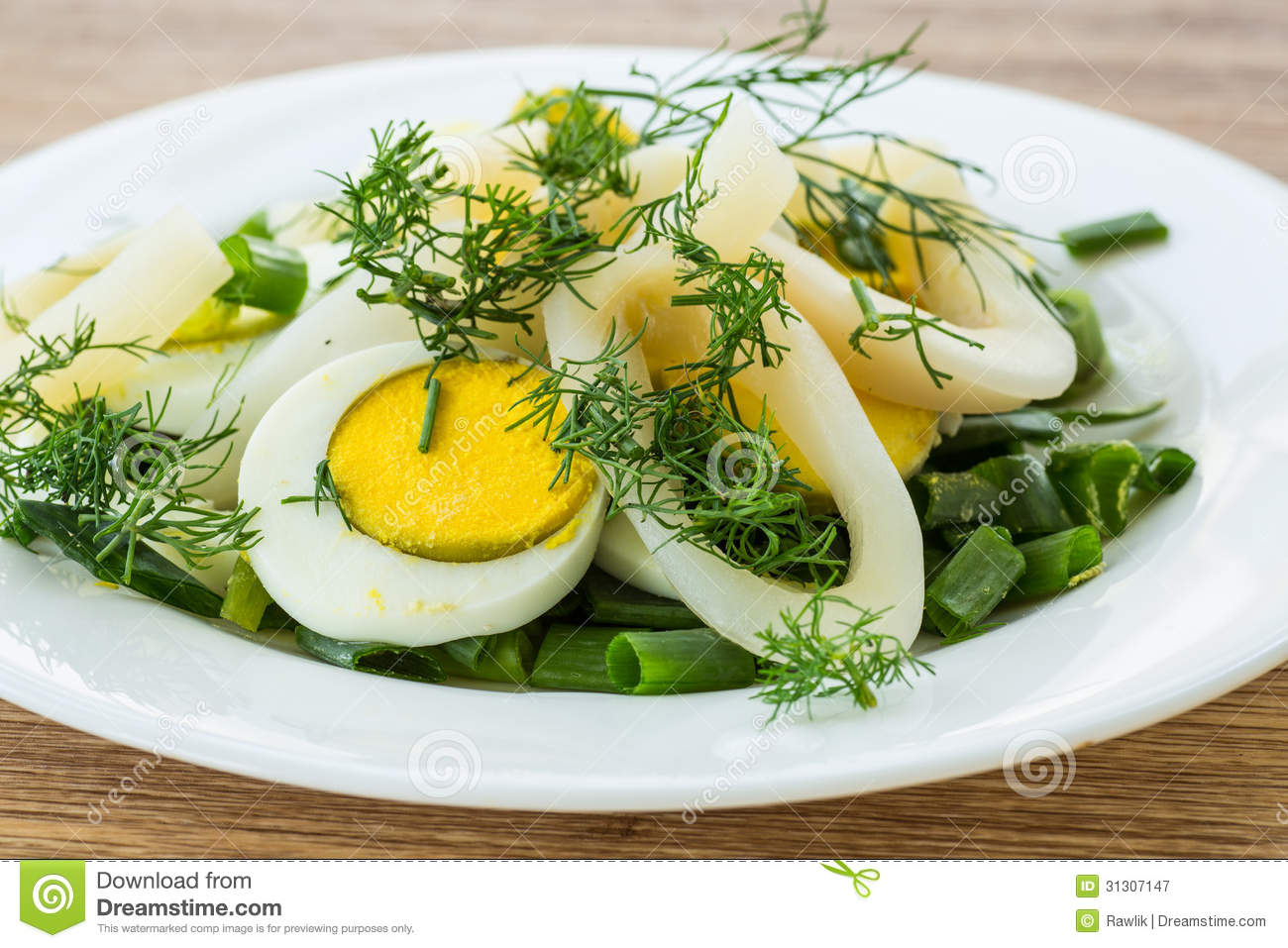 Royalty Free Stock Photography: Salad with squid and eggs