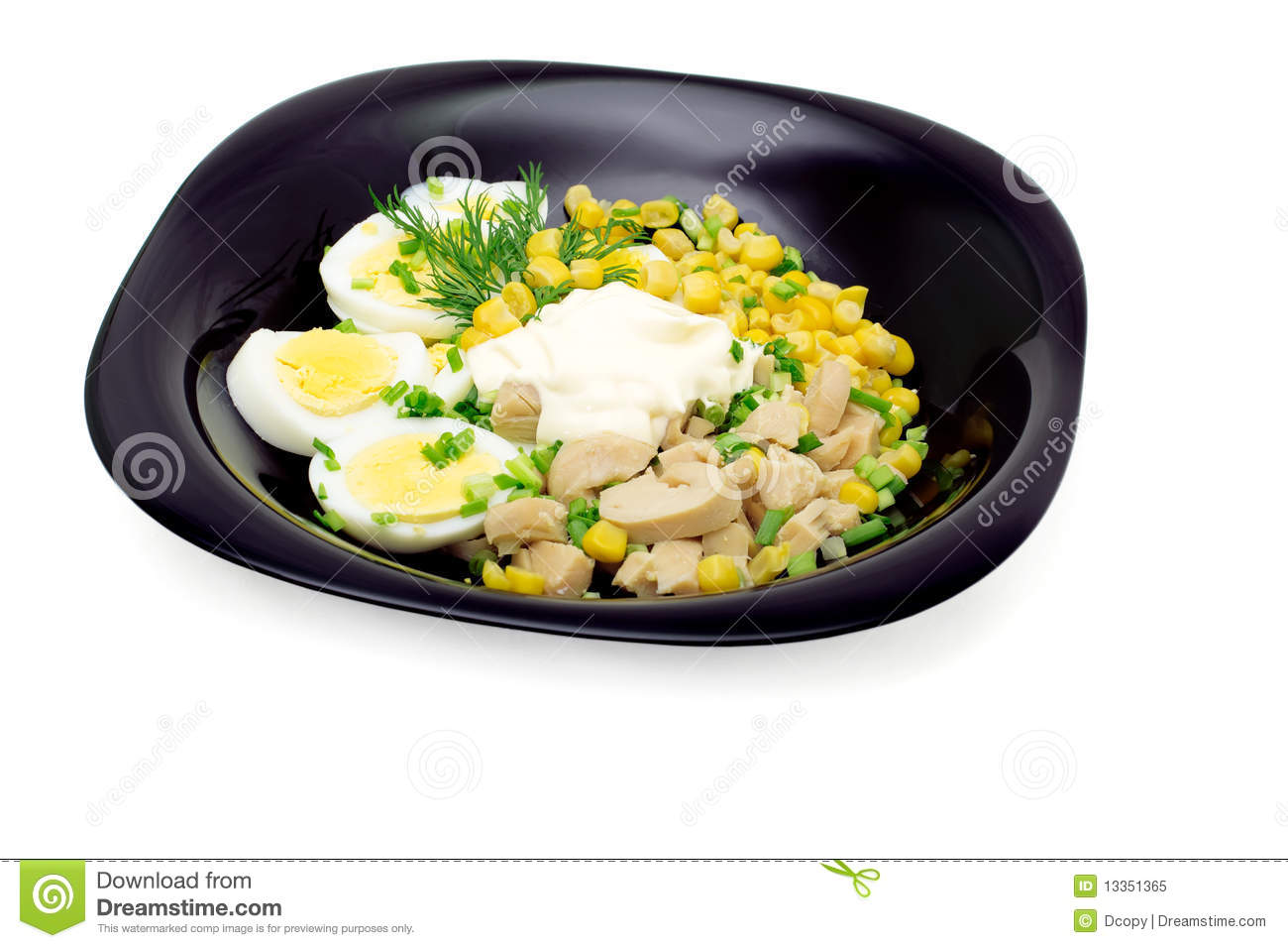 Salad of squid meat, eggs, canning corn with mayon
