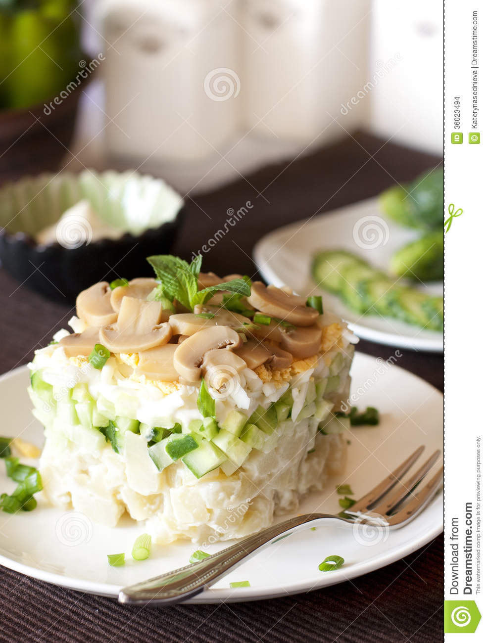 Salad with potatoes, eggs, mushrooms and pickled cucumbers, mayonnaise ...