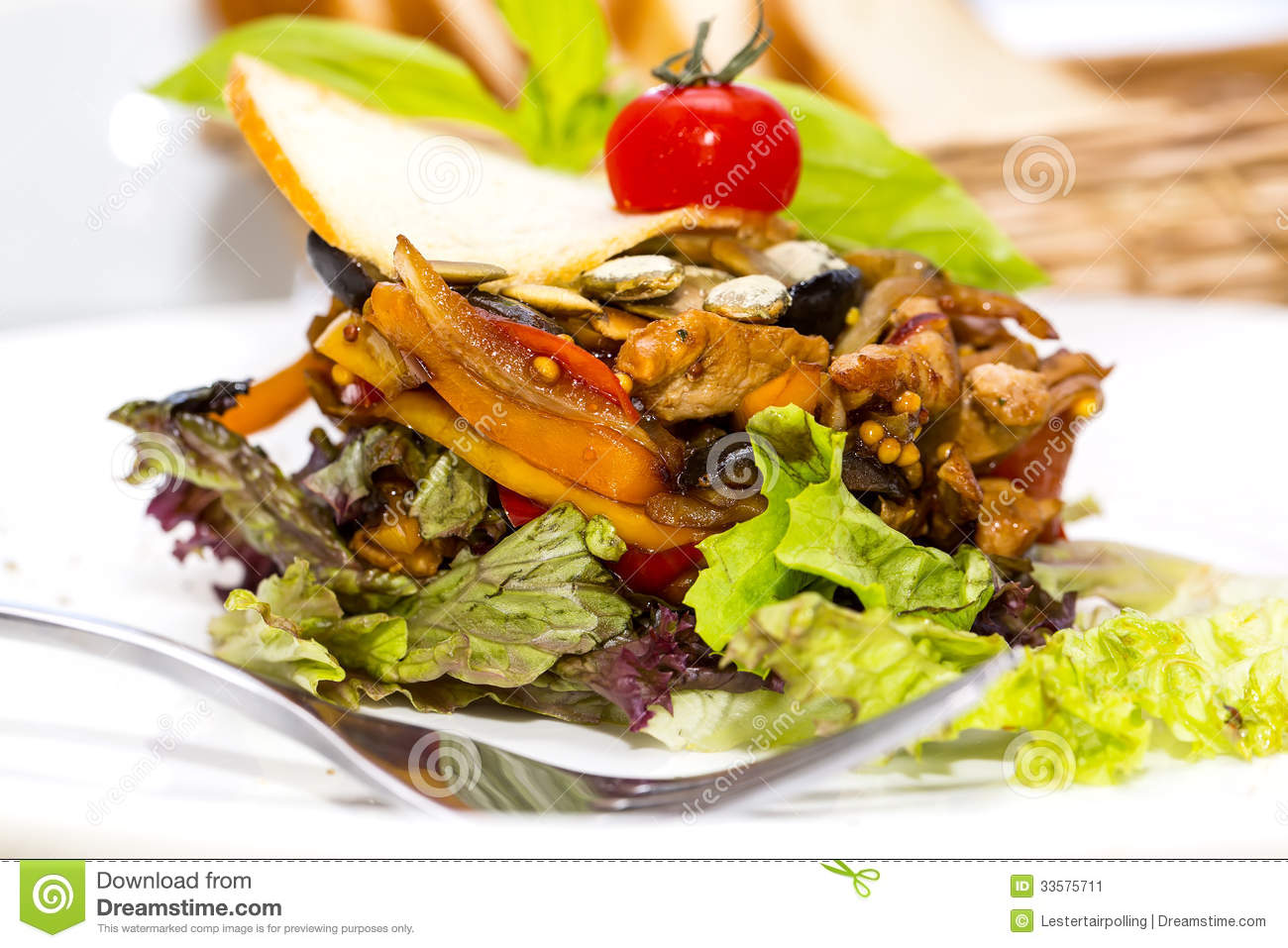 Salad with vegetables and meat on restaurant.
