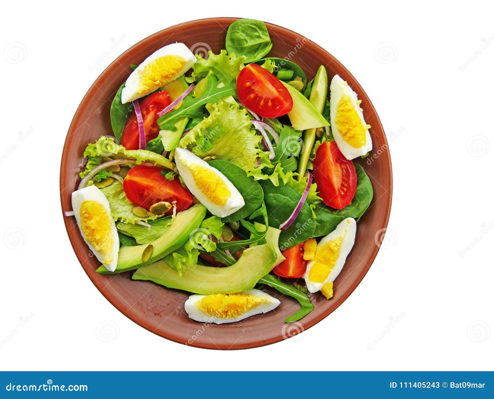 salade verte avec l'arugula, épinards de bébé, avocat d'isolement