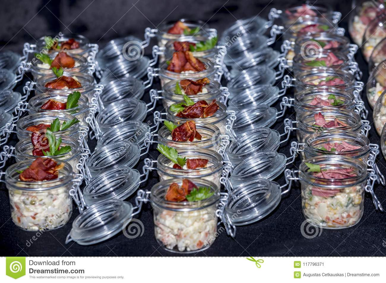Salads with meat in a glass jar