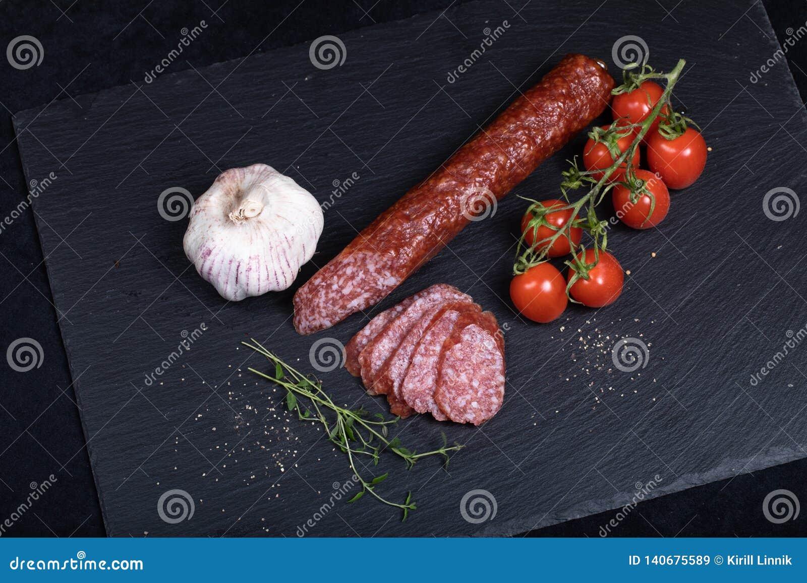 Salami on black stone plate