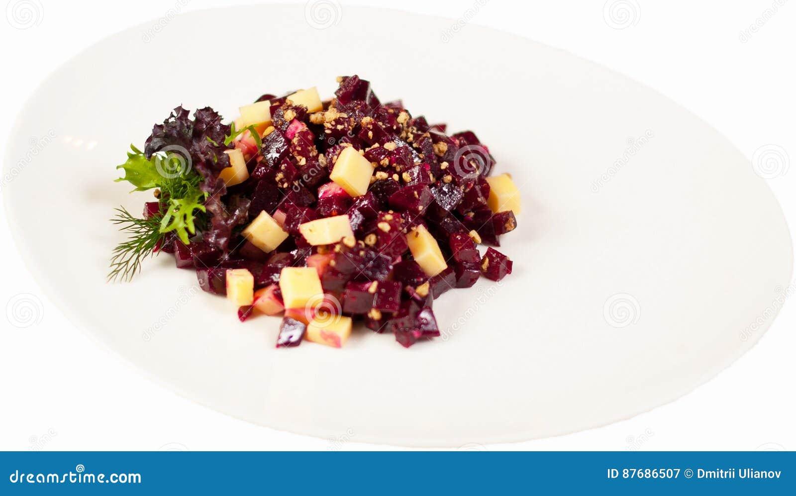Salatessigsoße auf einer Platte auf einem weißen Hintergrund lokalisierte nah oben