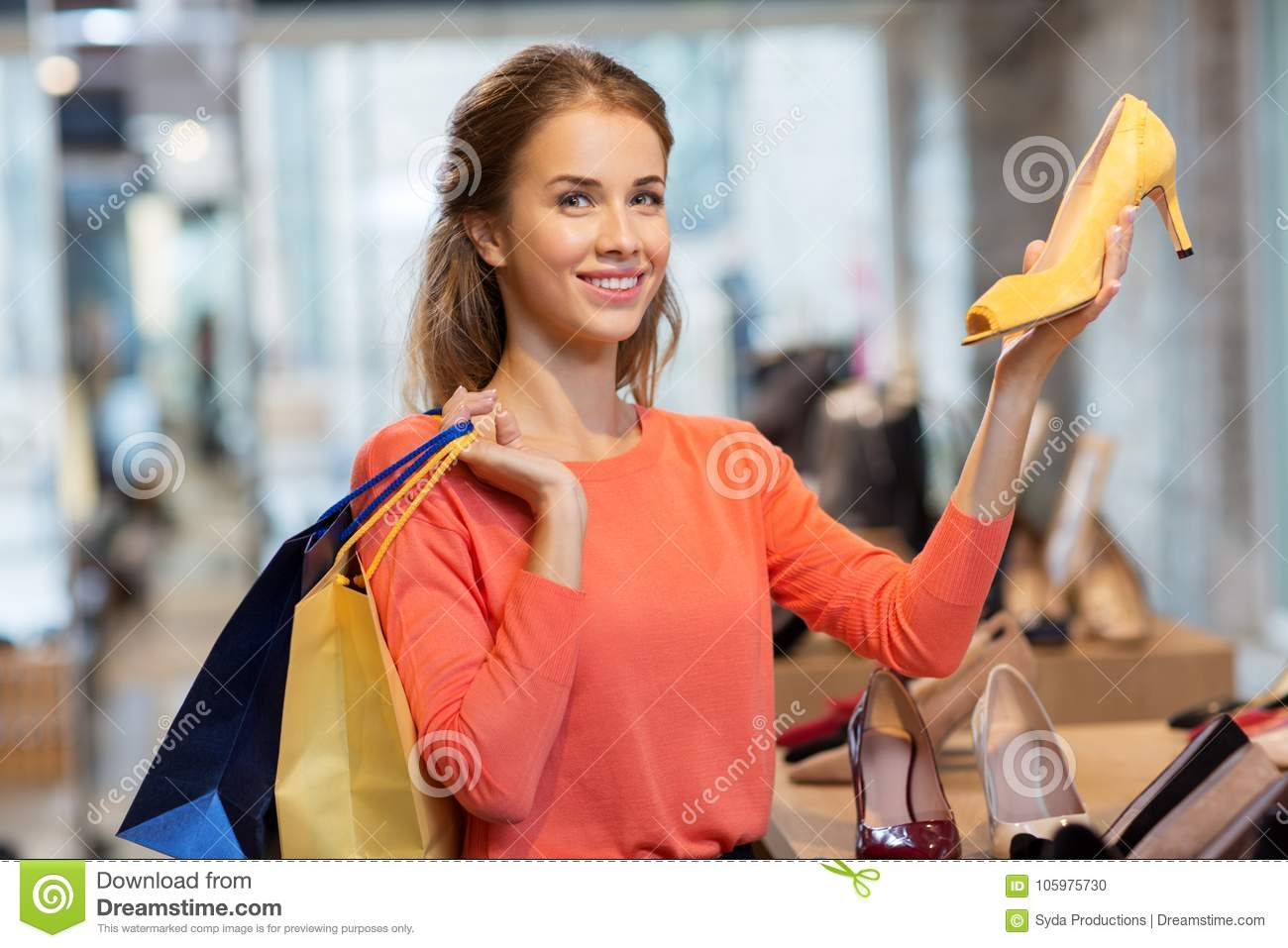 Happy Young Woman Choosing Shoes At Store Stock Photo ...