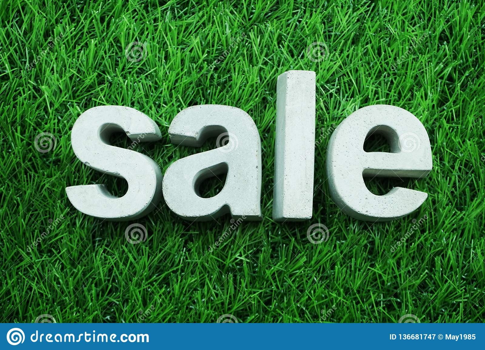 Sale Made From Concrete Alphabet On Green Grass Business