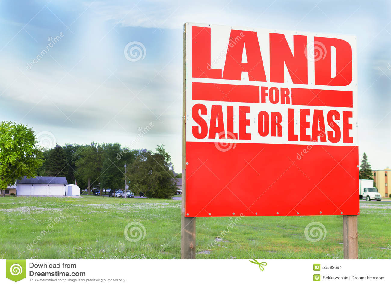 For sale sign outside property and land sale or lease