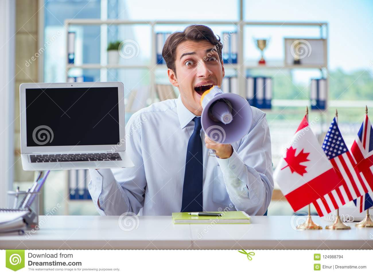 The Sales Agent Working In Travel Agency Stock Photo - Image