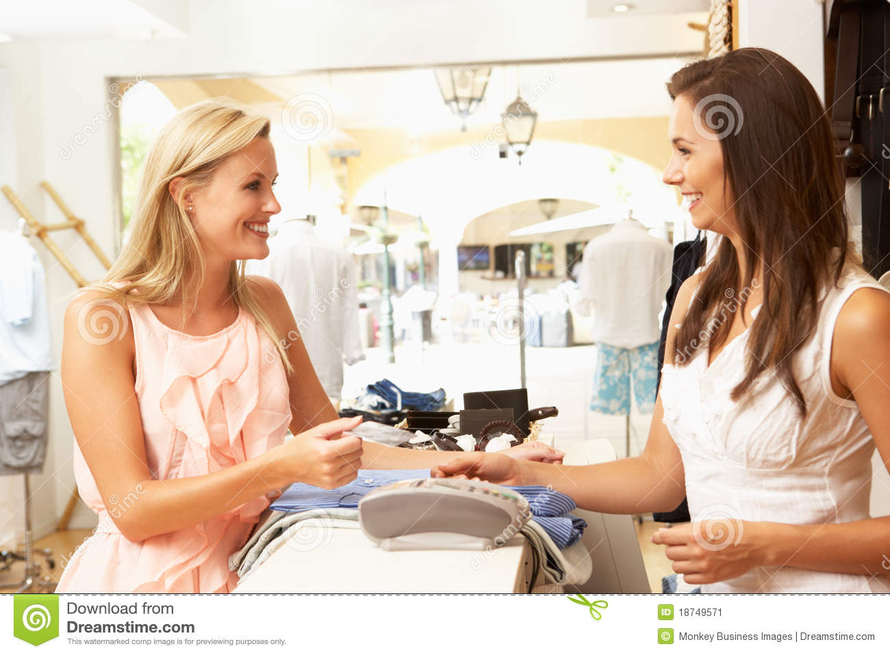s stock photos images pictures images s assistant at checkout of clothing store stock image