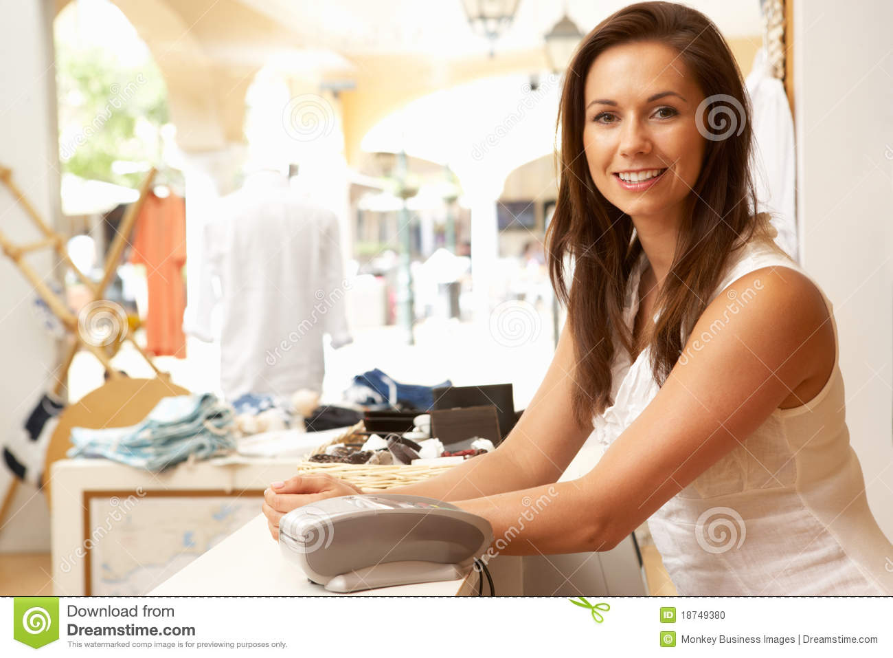 male s assistant at checkout of clothing store royalty s assistant in clothing store stock photo
