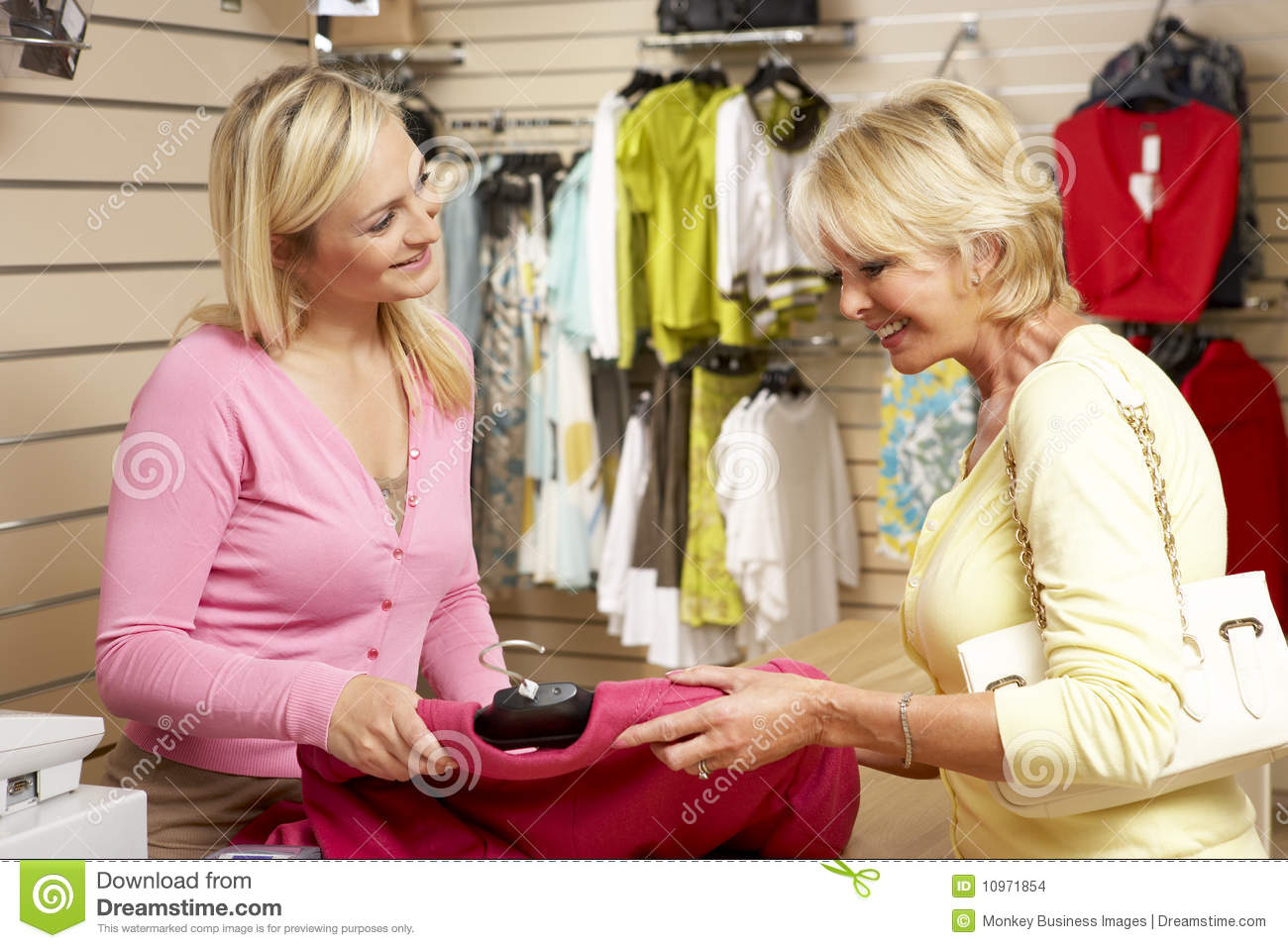 s stock photos images pictures images s assistant customer in clothing store stock images