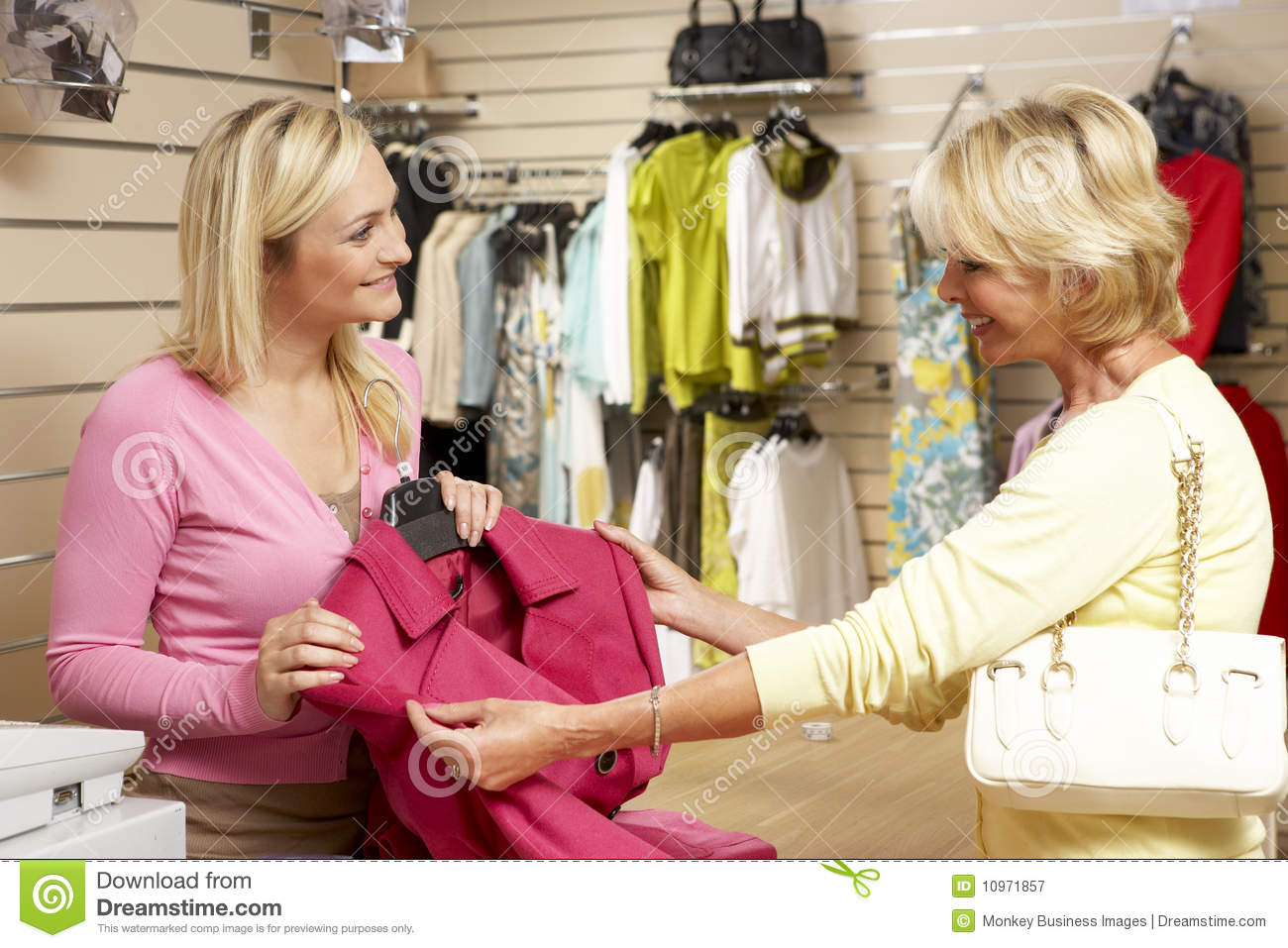 s assistant customer in clothing store royalty stock s assistant customer in clothing store