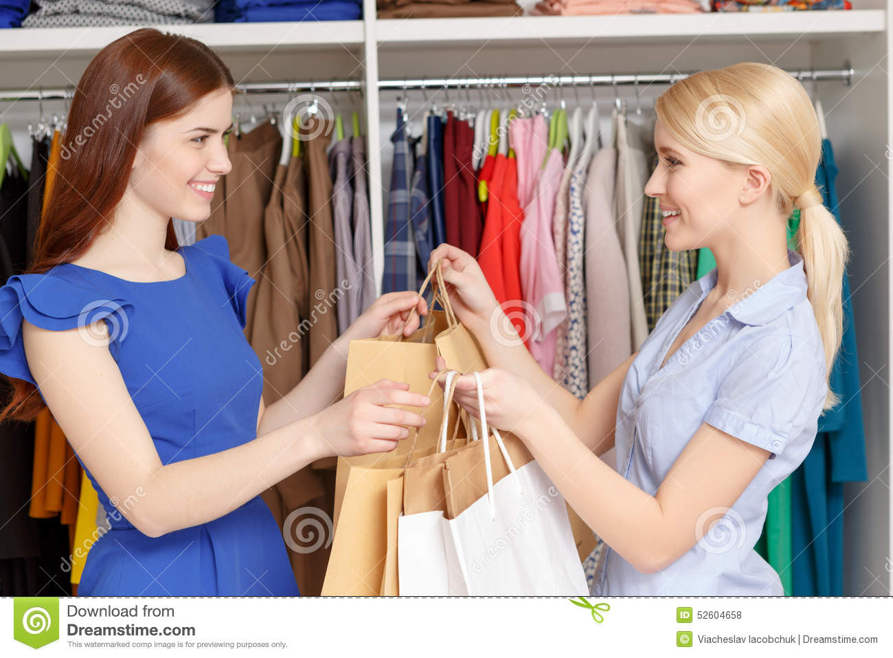 Sales Assistant Gives Bags To The Customer Stock Photo ...