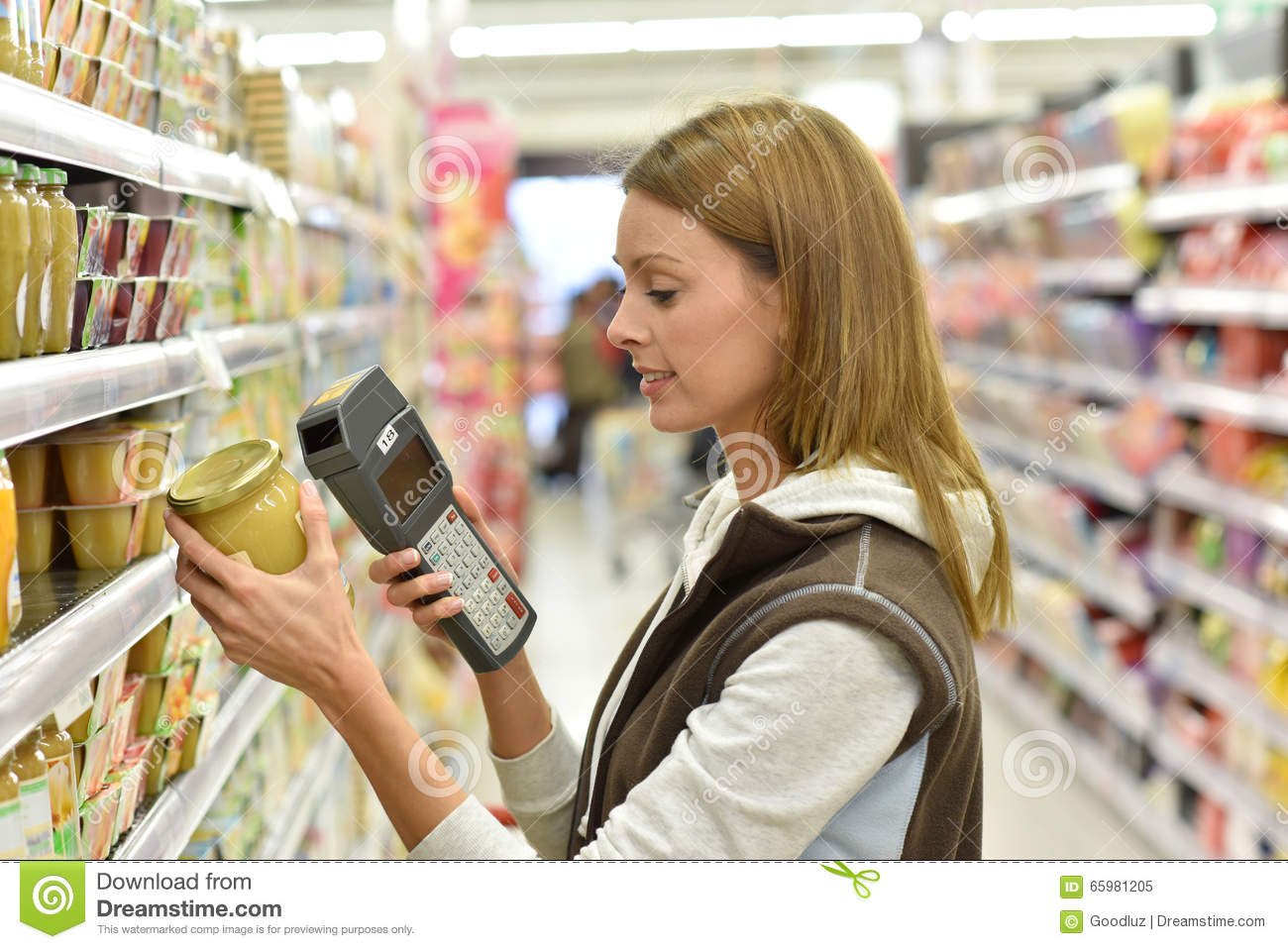 s assistant in grocery store scanning products stock photo s assistant in grocery store scanning products