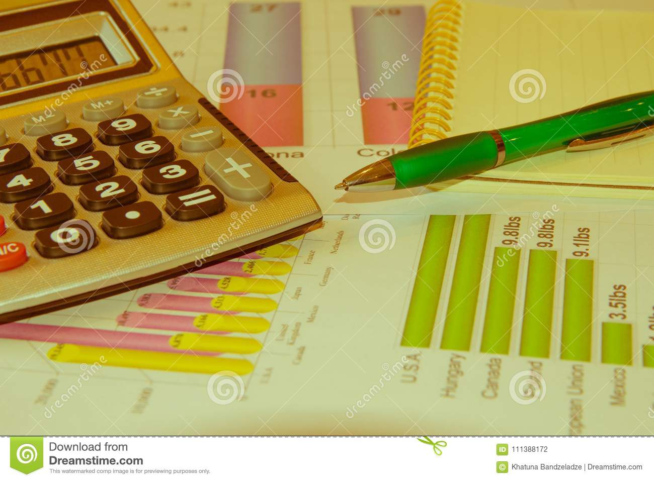 sales report analysis with pen and calculator stock photo image of