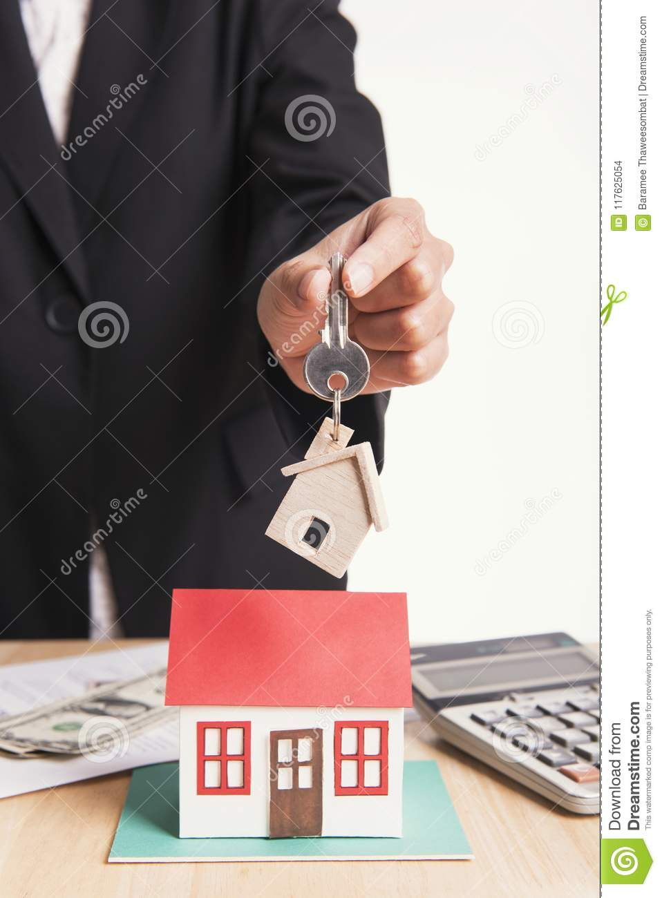 Salesman Agent Exchange Key House With Customer After Agreement