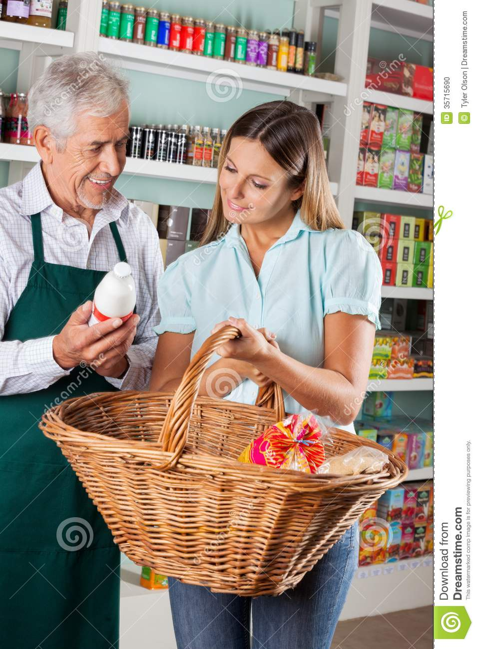 Buying A Full Face Snorkel Mask Reviews Of Full Face: Salesman Assisting Customer Buying Groceries Stock Photo
