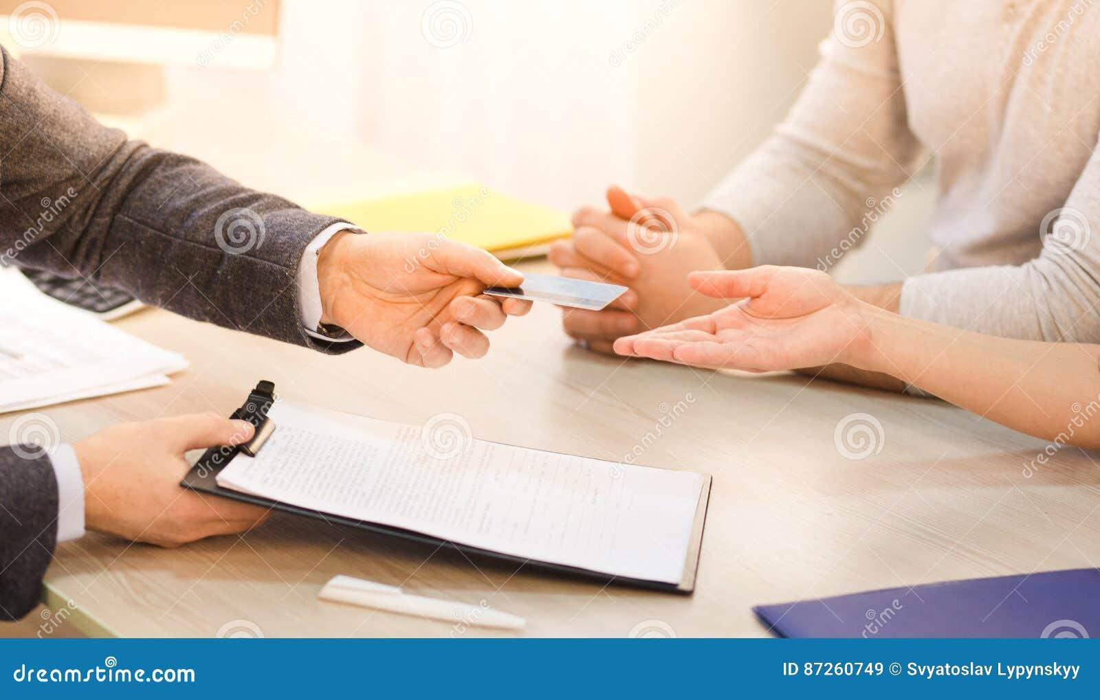 Salesman giving credit card