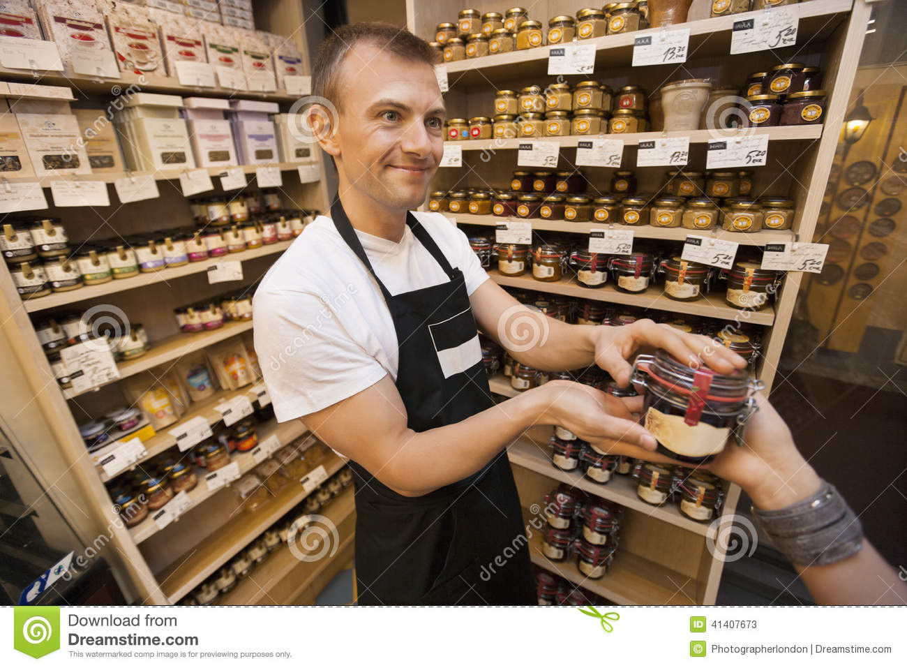 jam to female customer in grocery store stock photo   image 41407673