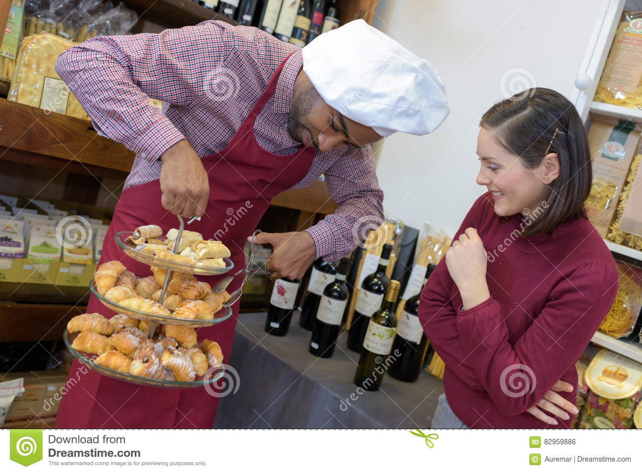 Salesman Giving Woman Advice On Buying Bottle Red Wine ...