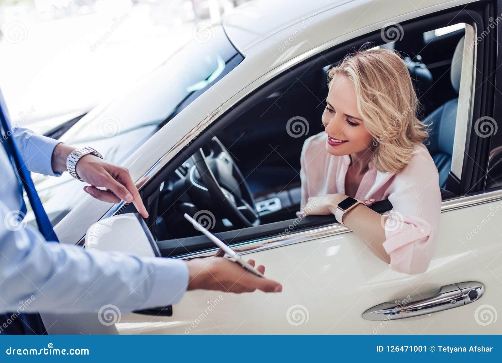 Salesman showing woman something on digital tablet