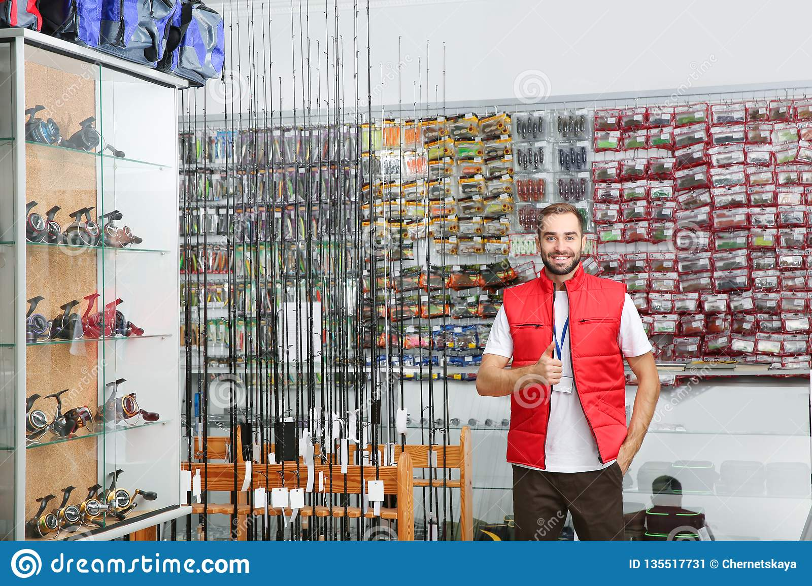 Salesman Standing Near Showcase With Fishing Equipment In Sports Shop Stock Image Image Of Catch Caucasian 135517731