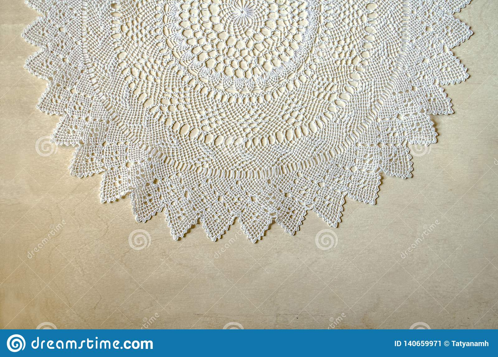 Card border from openwork white napkin lying on top of light plywood