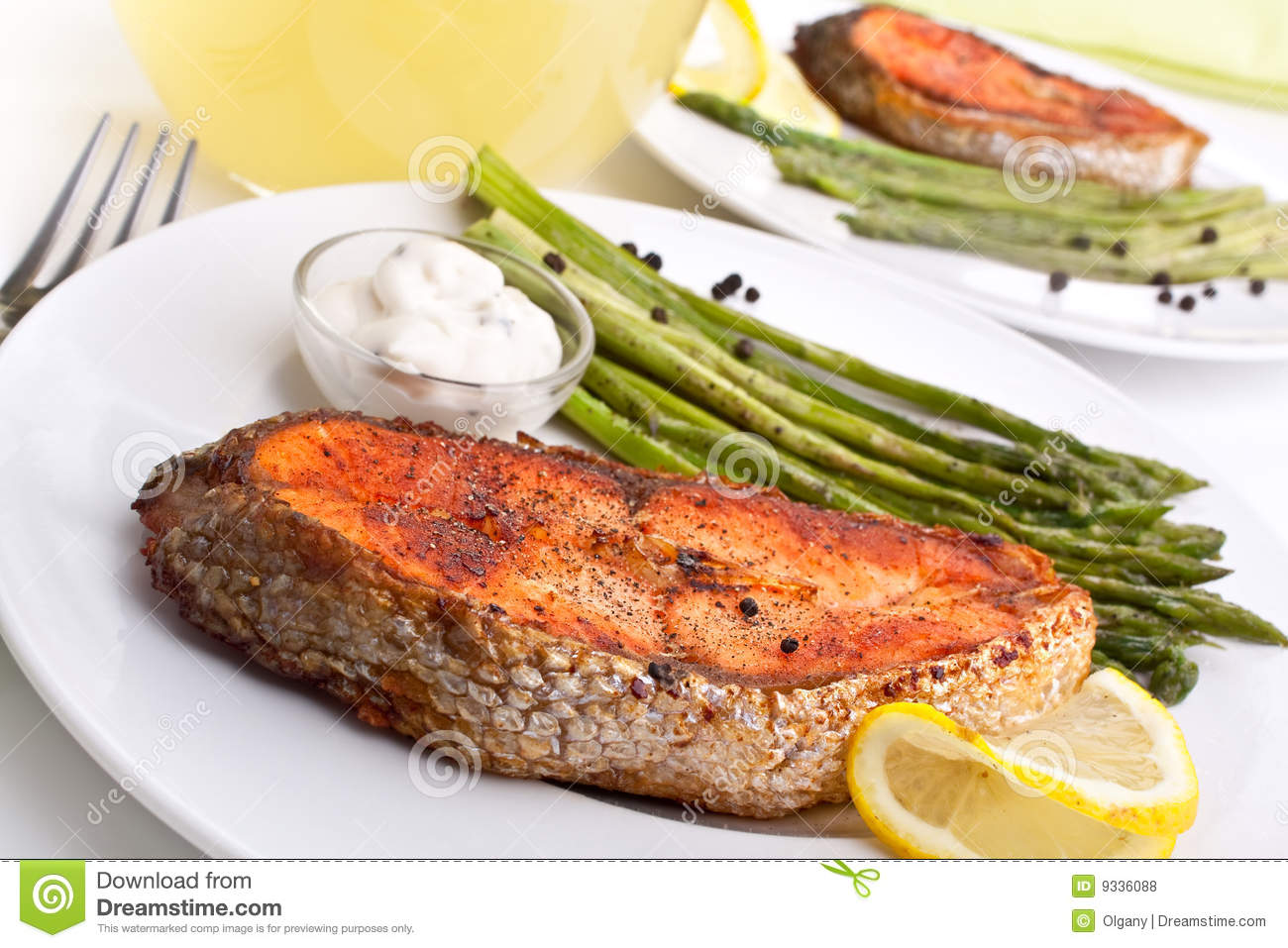 Grilled salmon with asparagus, lemon and cream sauce.