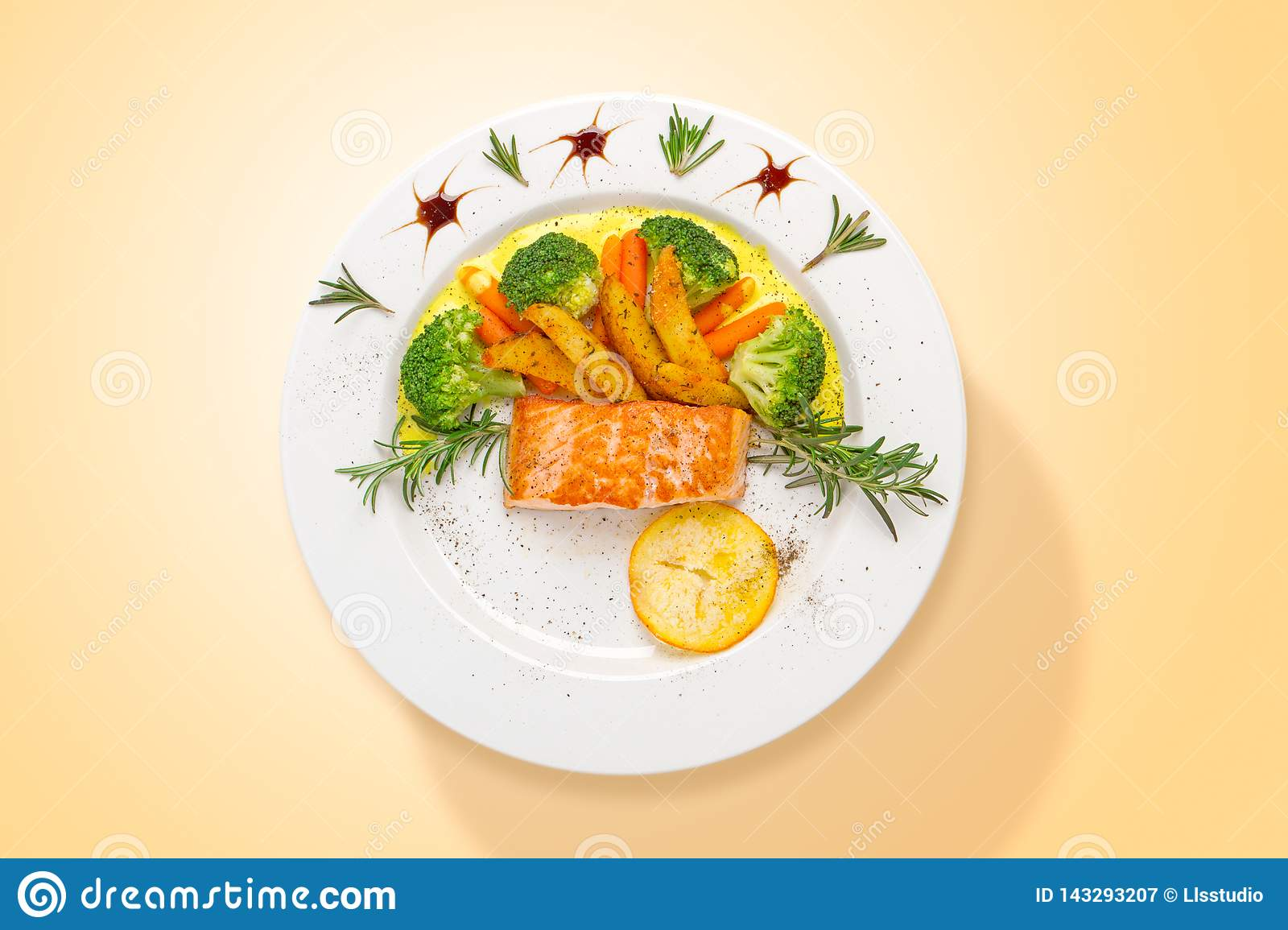Salmon with curry sauce and fresh vegetables. Top view