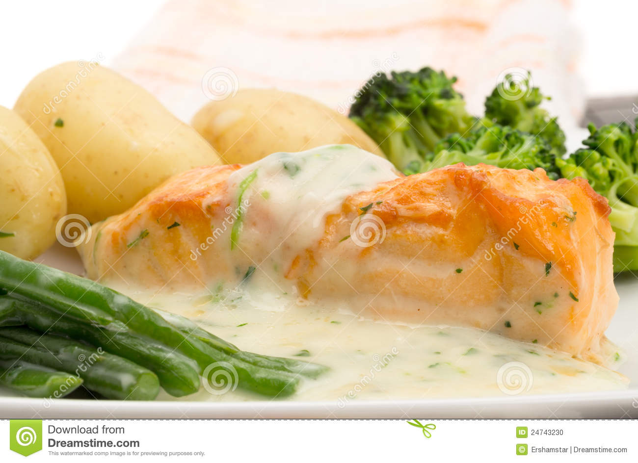 Salmon fillet with new potatoes, broccoli, green beans and a creamy ...