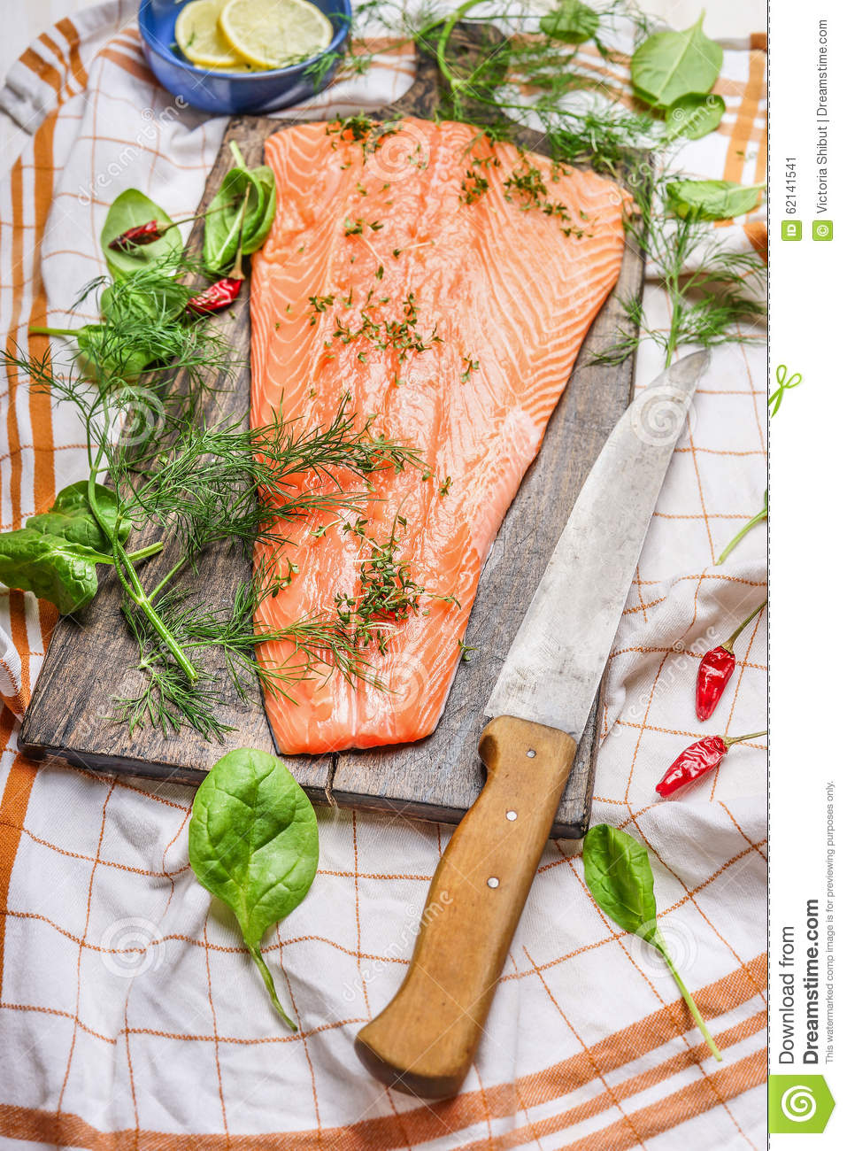 Salmon fish fillets on cutting board with knife and fresh for Fish fillet board