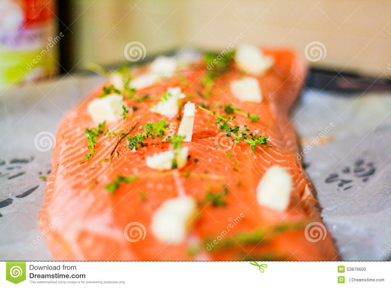 Salmon fish before putting it in the oven with some butter and thyme.
