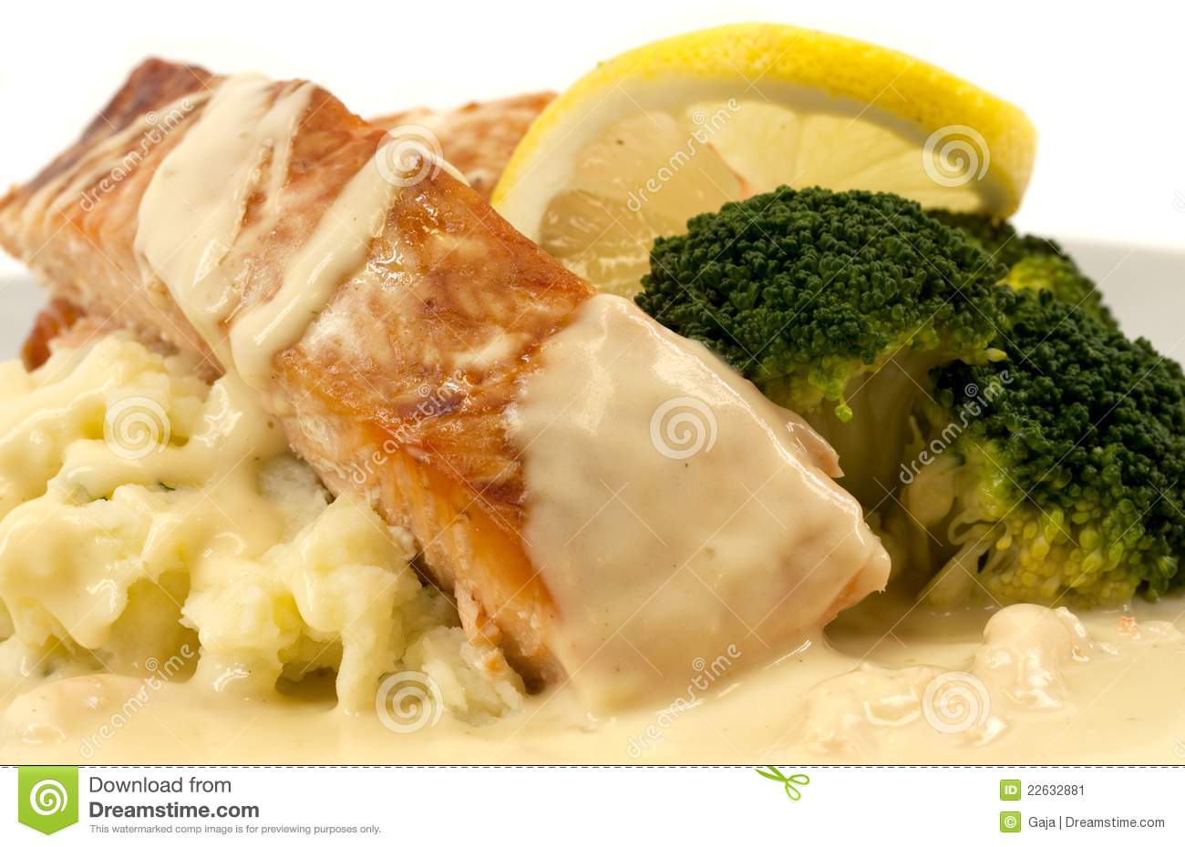 Salmon with mashed potatoes, broccoli, and creamed lemon shrimp sauce.