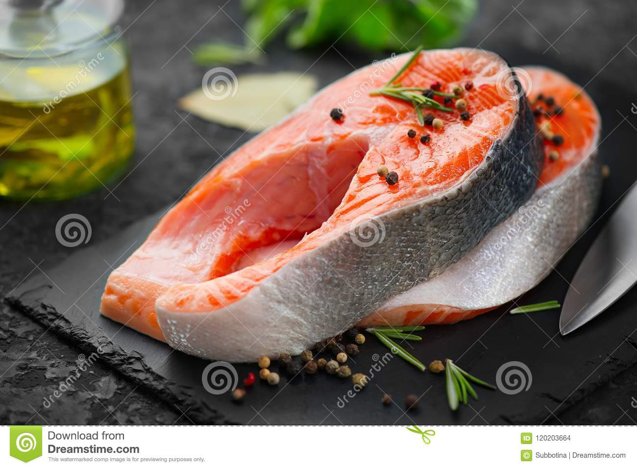 Salmon Raw Trout Fish Steak With Herbs On Black Slate Background