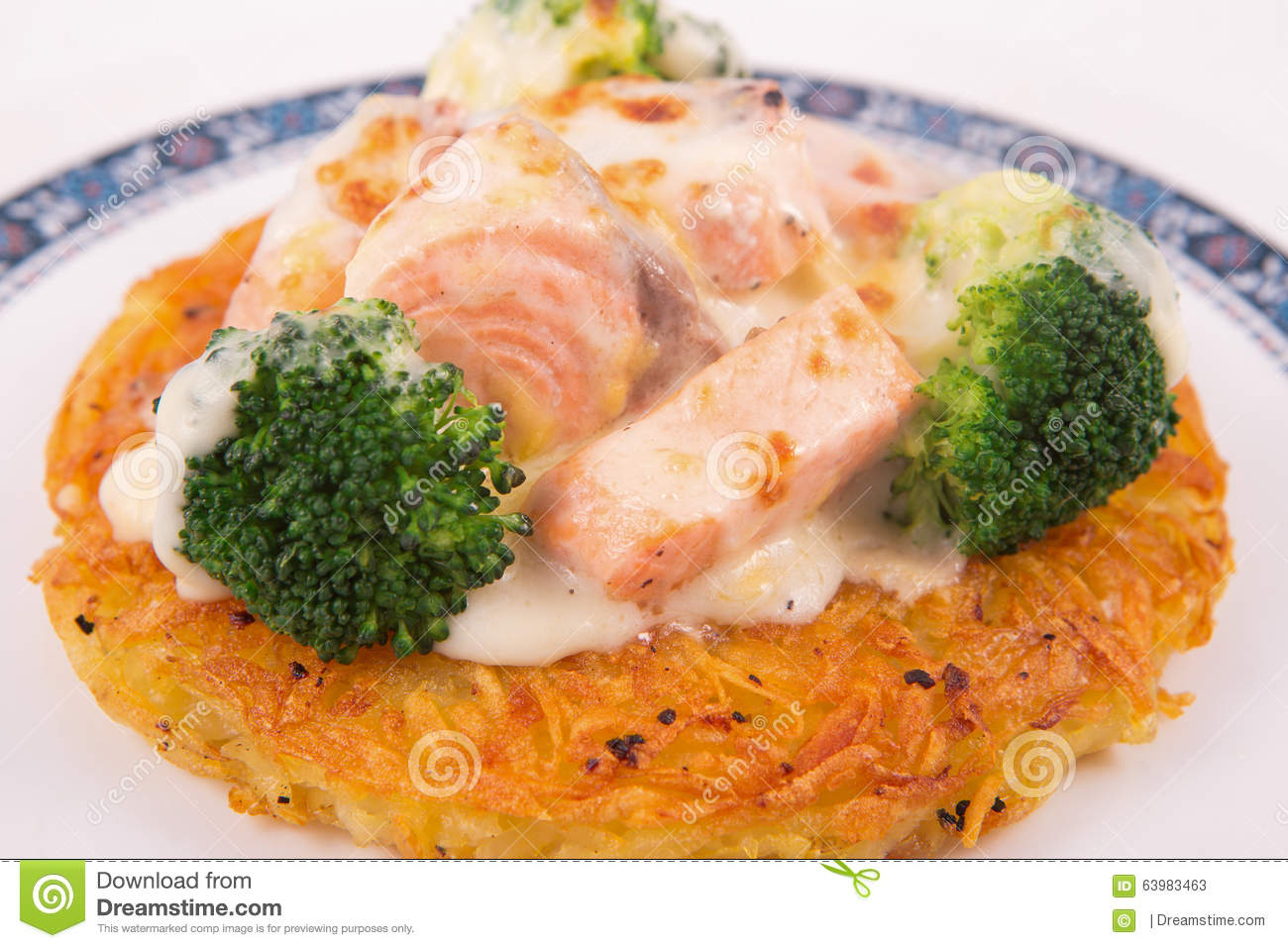 Salmon Rosti Served With Boiled Broccoli And White Bechamel Sauce ...