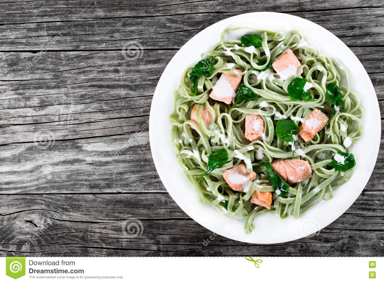 Salmon and Spinach Fettuccine pasta on white dishes