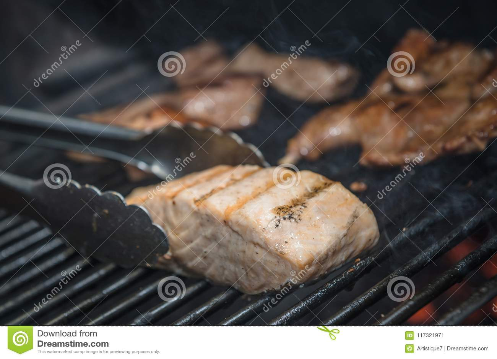 Salmon Steak Bluefin Being Prepared in Josper