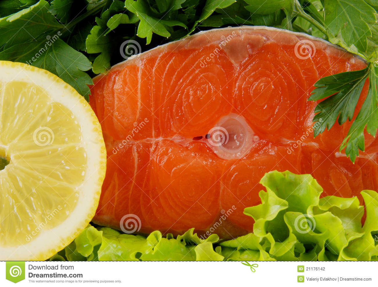 Salmon steak with greens and lemon
