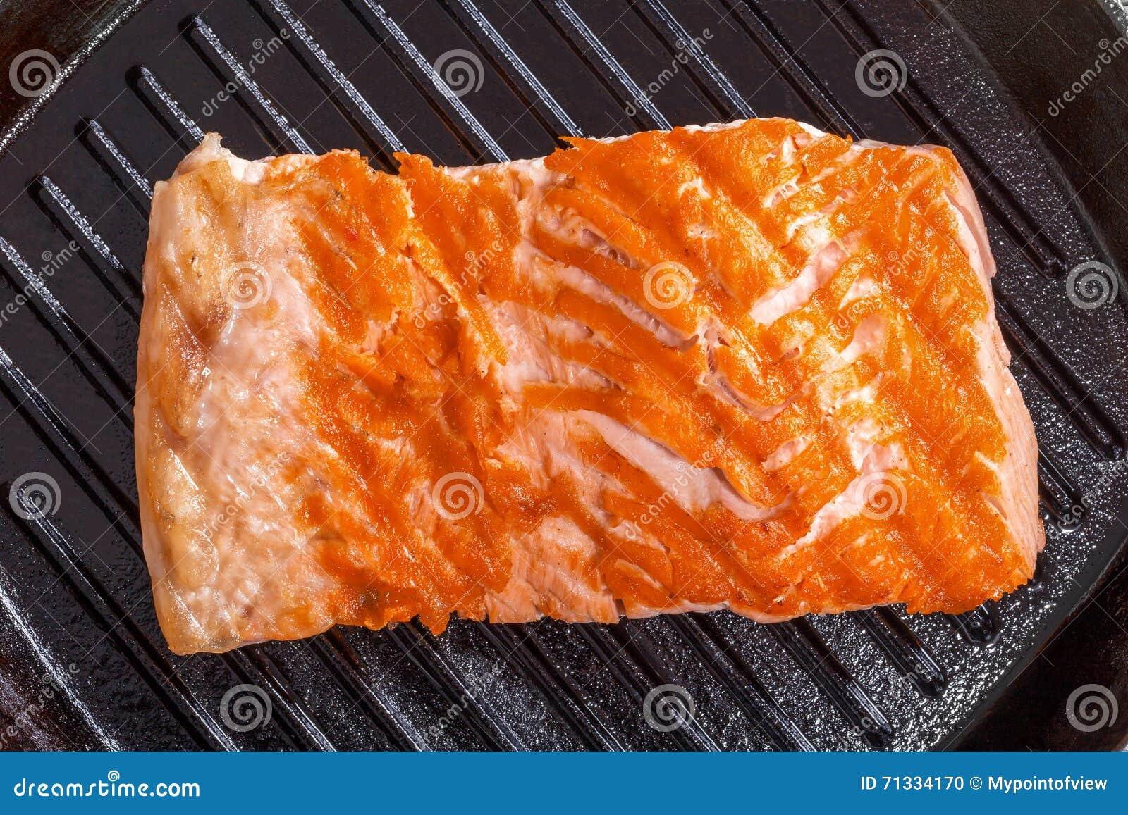 Salmon steak on a iron gril pan