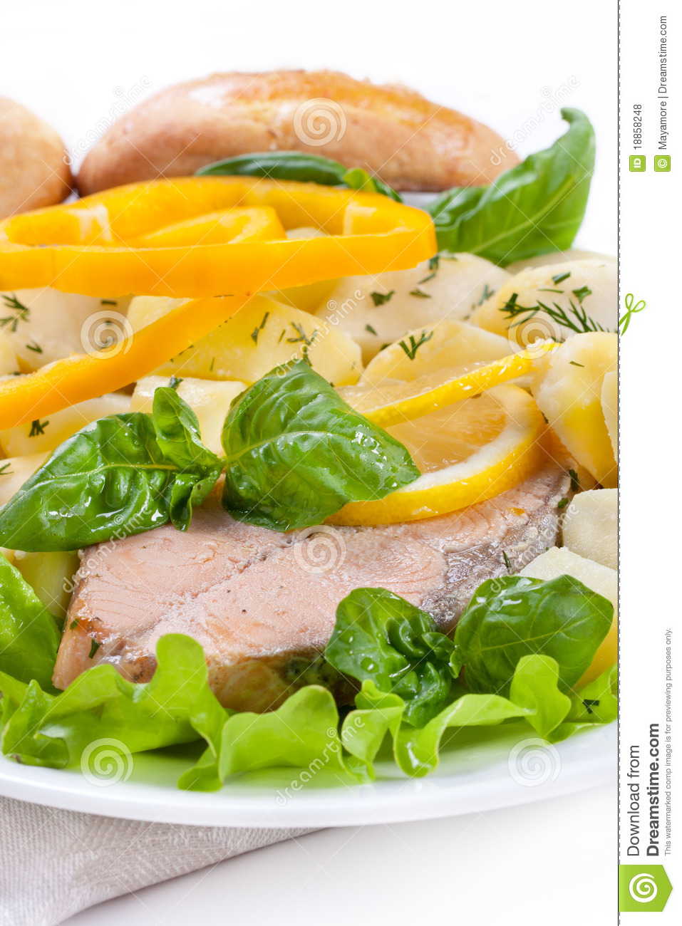 Salmon steak with potatoes and lemon.