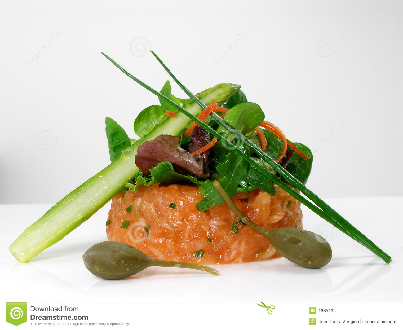 Stock Images: Salmon tartar with salad, green asparagus and capers