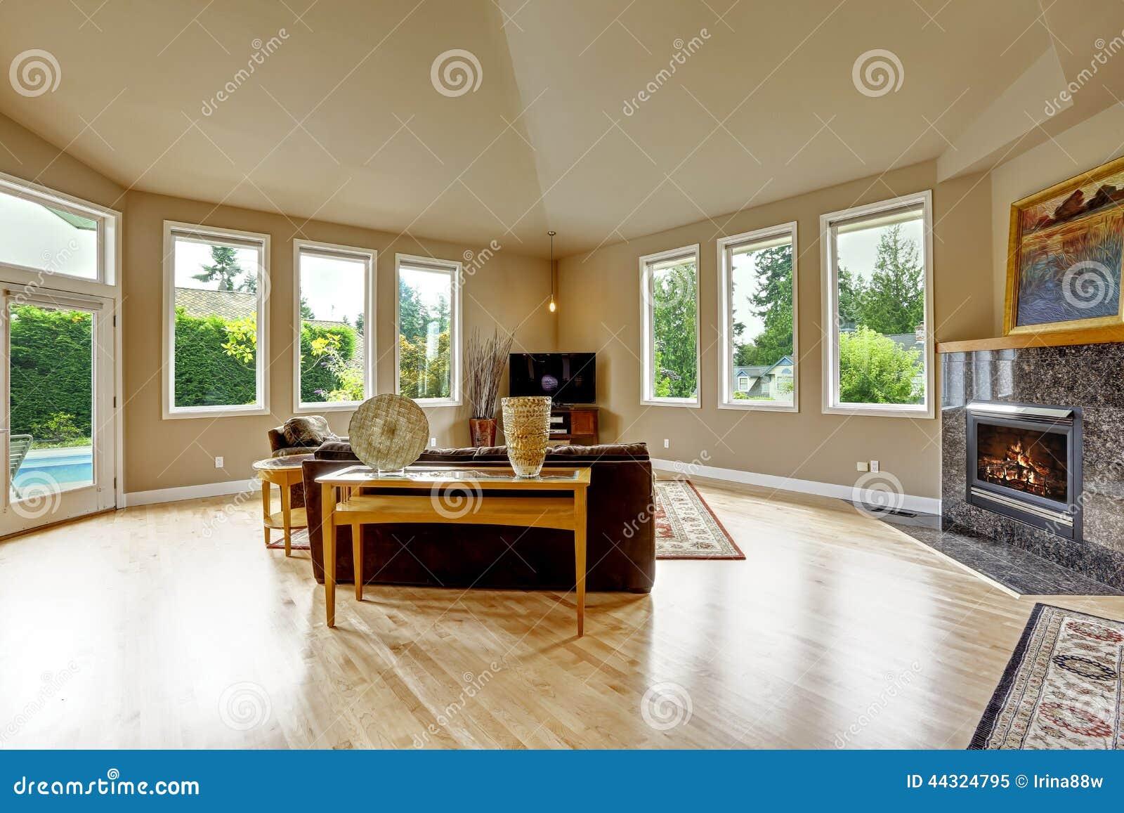 cool beau salon brun et beige avec le plafond vot photo