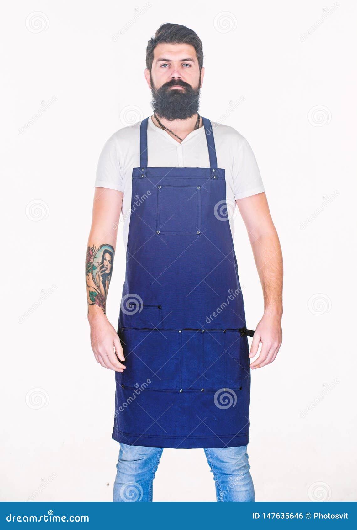 Salone del barbiere del parrucchiere per gli uomini Pantaloni a vita bassa barbuti brutali dell uomo con l uniforme del grembiule