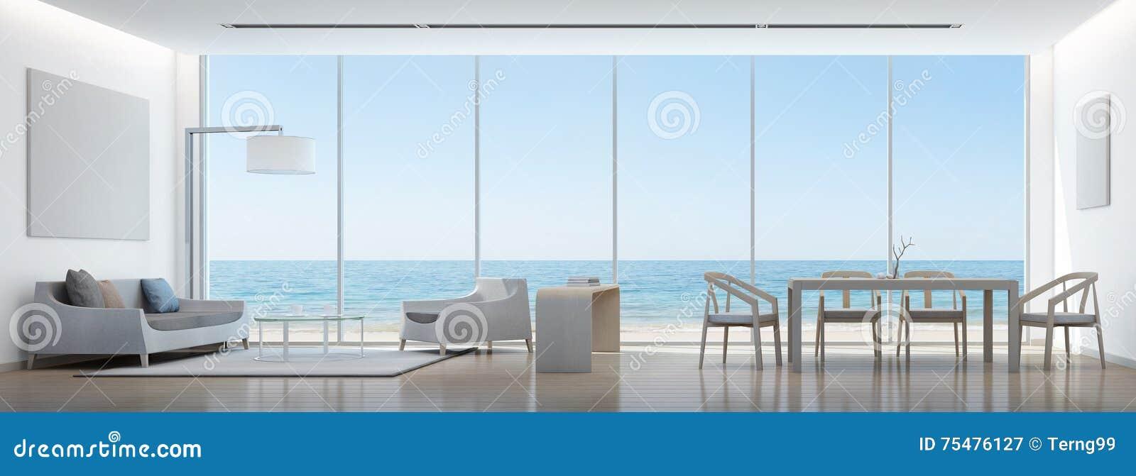 Salone e sala da pranzo di vista del mare in casa moderna for Casa moderna bianca