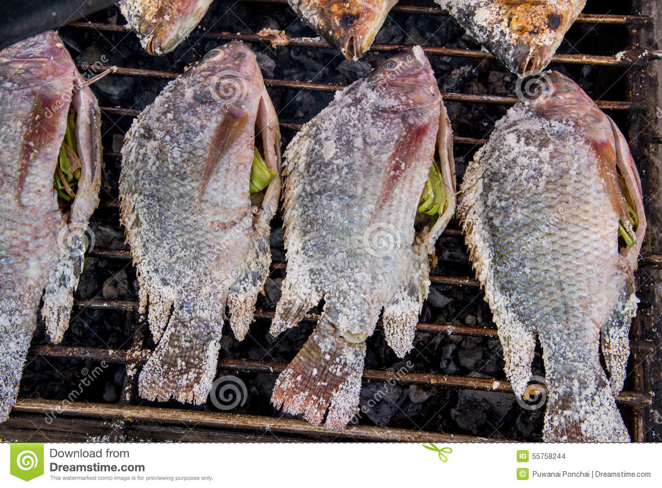 Salt crusted grilled fish in the local market of thailand for Fish skin for burns